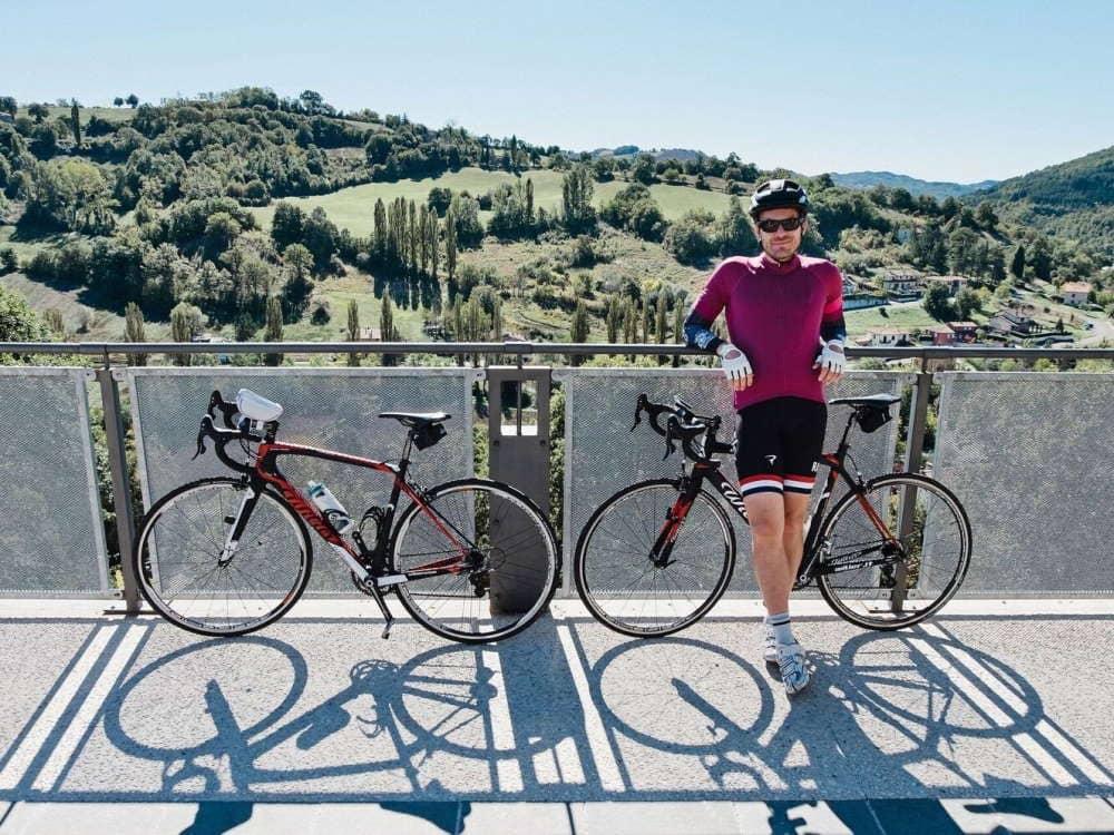 Road biker in Umbrian landscape