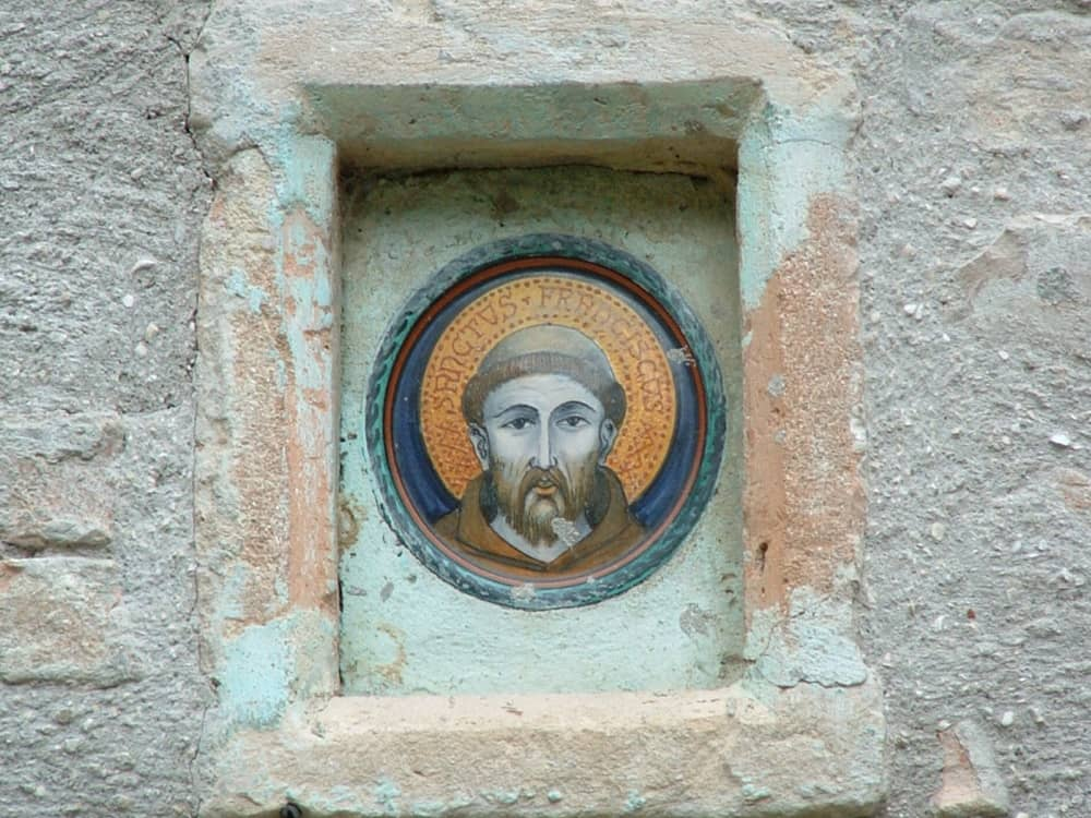 tile with face of Saint Francis